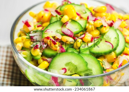 Food vegetable salad with corn and cucumbers healthy green meal - stock photo