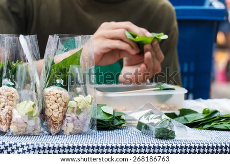 Food wrapped in leaves or Miang Kham sold as local market, Thailand-2 - stock photo