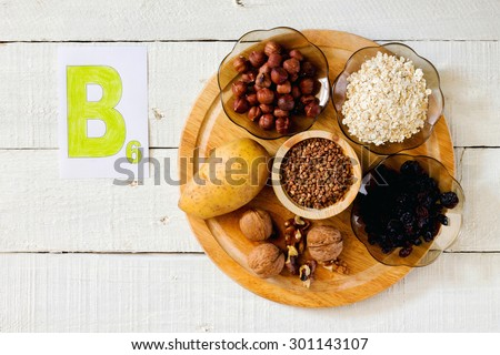 Foods containing vitamin B 6: hazelnuts, potatoes, oatmeal, raisin, buckwheat, walnuts - stock photo