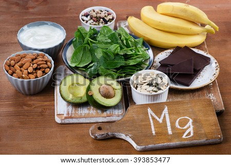 Foods High in Magnesium on  wooden table. Healthy eating. - stock photo