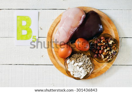 Foods that contain vitamin B 5: walnuts, hazelnuts, sunflower seeds, pumpkin seeds, meat, liver, eggs - stock photo