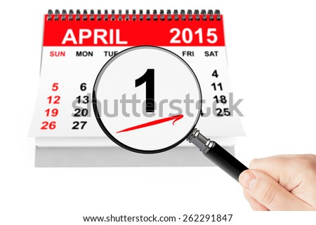 Fools' Day Concept. 1 april 2015 calendar with magnifier on a white background - stock photo