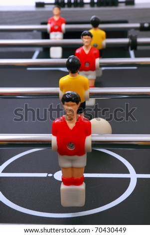 foosball table soccer little men playing game - stock photo