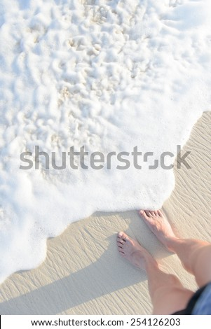 Foot and legs on the beach - men, male - stock photo