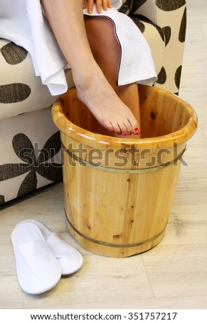 Foot-bath in oriental herb water for body detox - stock photo