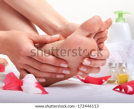 Foot care and massage  - stock photo