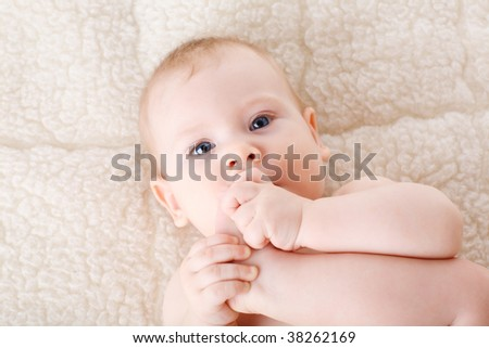 foot in the mouth of the child - stock photo