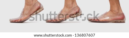 Foot in transparent shoe walking sequence - stock photo