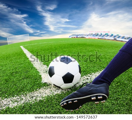 foot kicking soccer ball - stock photo