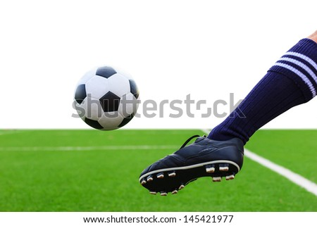 foot kicking soccer ball isolated on white background - stock photo