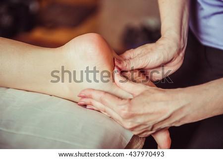 foot massage. massage of the feet in the spa salon - stock photo