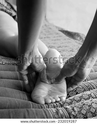 Foot massage, Reflexology concept - stock photo