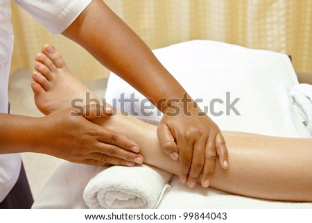 foot massage, spa foot oil treatment - stock photo