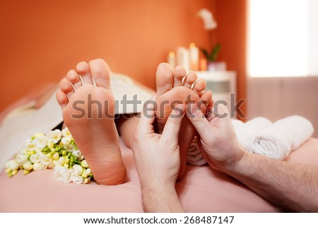 foot massage. spa treatments. close-up - stock photo