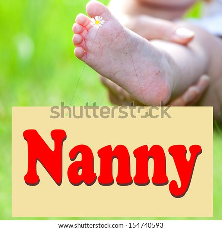 Foot of the child with Shield Nanny - stock photo