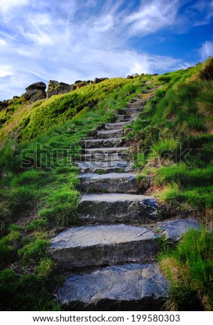 Foot path conservation and erosion prevention on open moorland using large flag stones to repair public paths and byways.  - stock photo