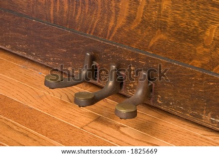 Foot Pedals of Antique Upright Piano - stock photo
