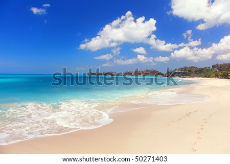Foot prints on a beautiful beach, Antigua - stock photo