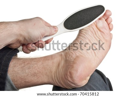 Foot resting on knee getting spa treatment - stock photo
