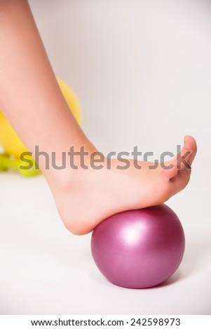 Foot rolling on a ball - stock photo