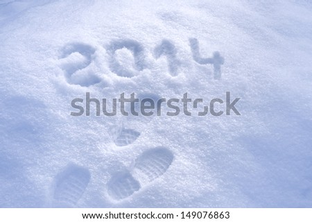 Foot step prints in snow, New Year 2014 concept - stock photo