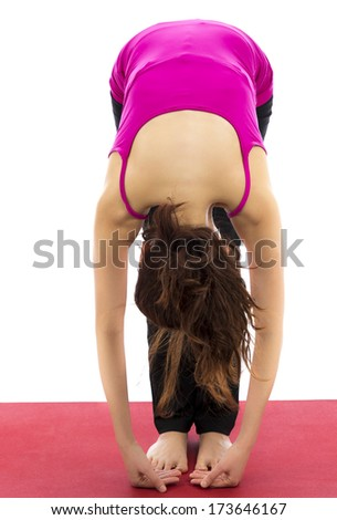 Foot to Fingers Forward Bend Pose in Yoga, Closeup Young woman doing foot to fingers forward bend pose in yoga (Series with the same model available) - stock photo