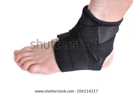 Foot Wrapped in a Black Ankle Brace Isolated on White - stock photo