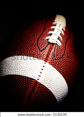 football against a dark background - stock photo