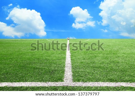 Football and Soccer field grass on the green background - stock photo