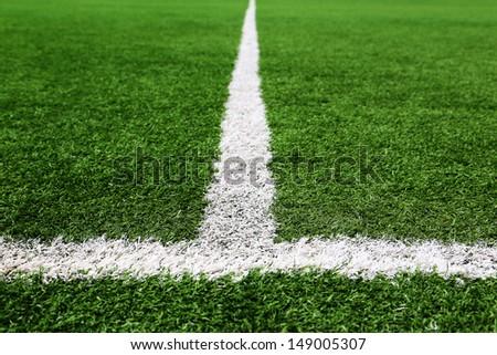 Football and soccer field grass stadium - stock photo