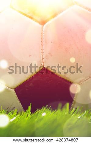football ball is lying on grass on field - stock photo