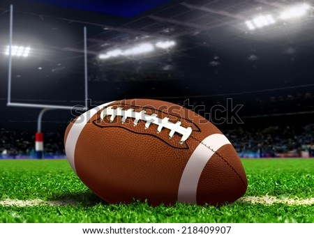 Football Ball on Grass in Stadium - stock photo