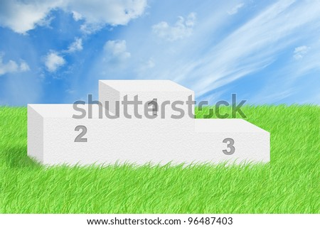 Football ball on green grass with blue cloudy sky. - stock photo