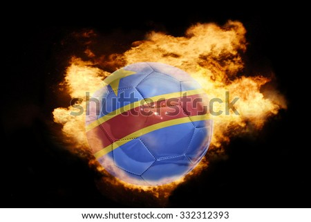 football ball with the national flag of democratic republic of the congo on fire on a black background - stock photo