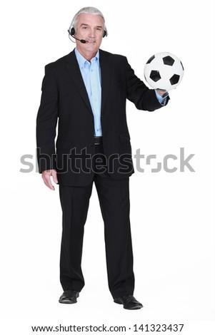 Football commentator - stock photo