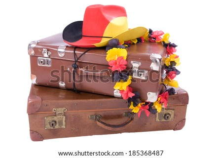 Football Cowboy Hut with flower necklace over two old suitcases - stock photo