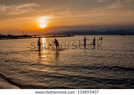 Football during sunset - stock photo