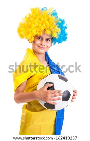 Football fan with a blue and yellow ukrainian flag painted on his face and a ball in hands on white background - stock photo