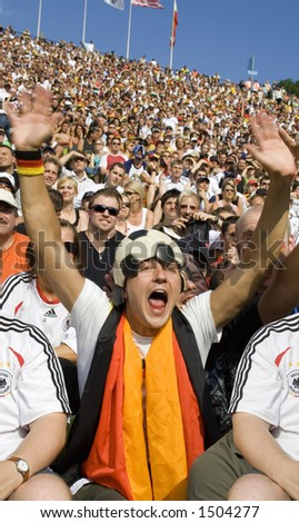 football fan with his hands in the air - stock photo