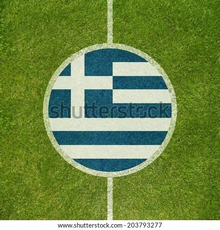 Football field center closeup with Greek flag in circle  - stock photo