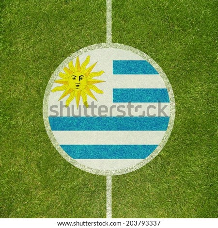 Football field center closeup with Uruguayan flag in circle  - stock photo
