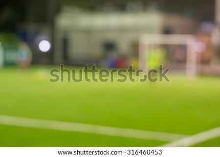 Football field on blur background - stock photo