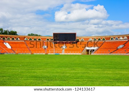 football field with green grass - stock photo
