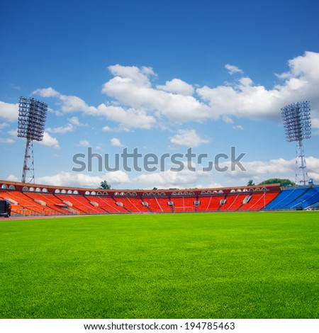 football field with green grass at sunny day - stock photo