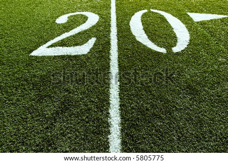 Football Field 20 yard line with Line splitting the frame - stock photo