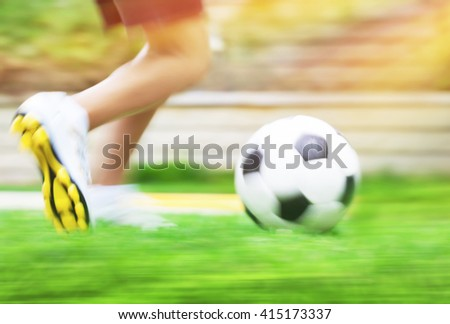 Football game slow motion, body part, sportive teen boy runs for ball, soccerl championship, active teens lifestyle, recreation and hobby - stock photo