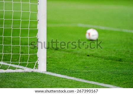 Football goal detail with a soccer ball in the background - stock photo