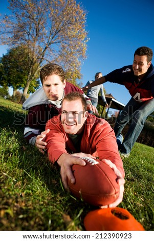 Football: Guy Stretches With Ball For Touchdown - stock photo