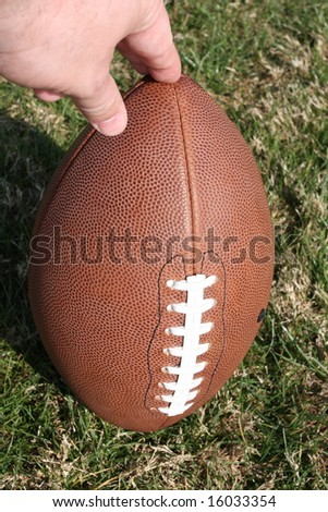 Football held for kickoff - stock photo