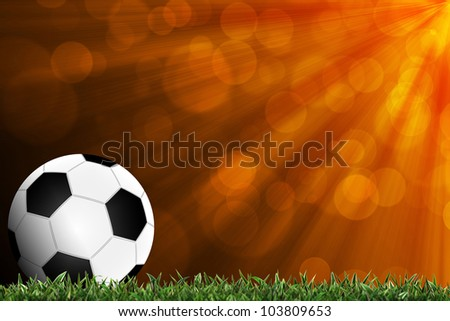 Football in green grass with background colorful - stock photo